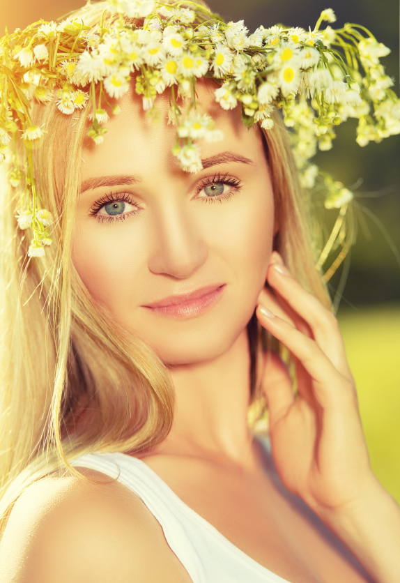 beautiful woman in wreath of flowers