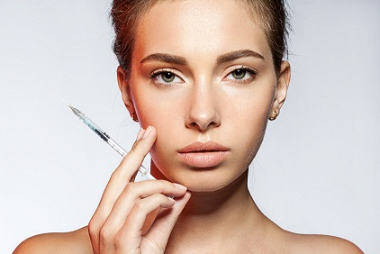 young woman with Botox injections in the syringe